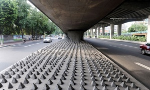 Mandatory Credit: Photo by Imaginechina/REX (1790320a) Rows of concrete spikes Concrete spikes built to stop homeless from sleeping under road bridge, Guangzhou city, Guangdong province, China - 02 Jul 2012 Rows of concrete spikes have been laid beneath a road bridge in Guangzhou city to allegedly discourage homeless people from sleeping there. A 30-meter-long area has been covered with the small spikes, each of which measures about 20cm tall. They are, reportedly, meant to stop people from sleeping rough but this explanation has been denied by the local administrative authority. However, they have not given any further details to explain why the spikes have been installed. CONCRETE SPIKES BUILT STOP HOMELESS FROM SLEEPING UNDER ROAD BRIDGE GUANGZHOU CITY GUANGDONG PROVINCE CHINA 02 JUL 2012 ROWS Not-Personality 13797718